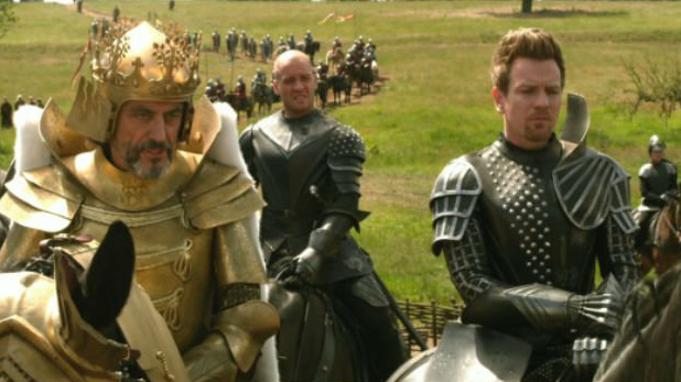Ewan McGregor is trying so hard to ignore Ian McShane's outfit.