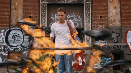 """Warner Bros. """"Oh great. If I had a quarter for every time a flaming bike has passed me on the sidewalk..."""""""